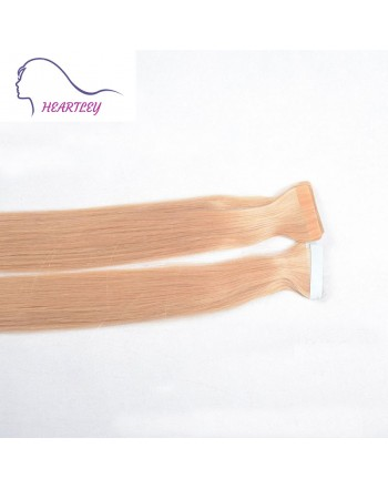light-strawberry-blonde-tape-in hair-extensions